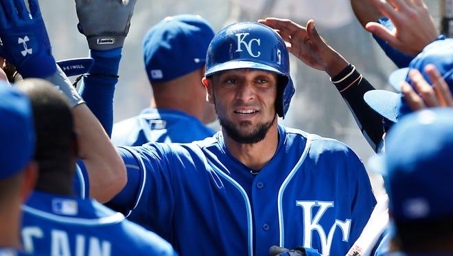 Kansas City Royals' Paulo Orlando is congratulated in the dugout after scoring on a double by Omar Infante in the seventh inning against the Los Angeles Angels.
