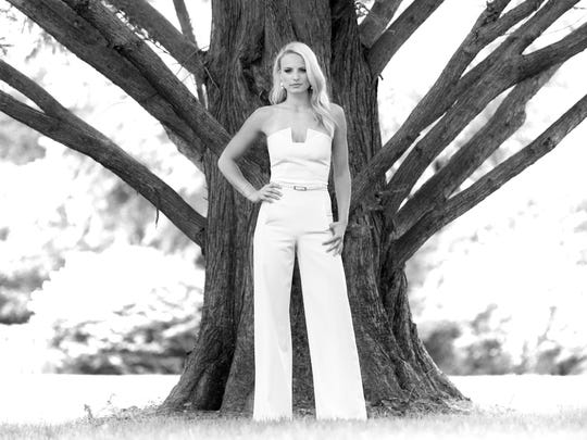 Miss Kentucky USA and UofL volleyball player Katie George poses by a tree behind her family's home.