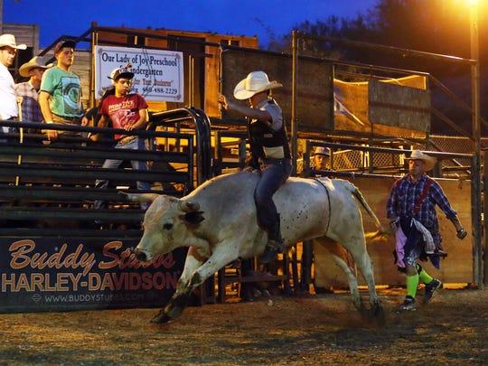 Hunter Kelly rides White Russian at the Buffalo Chip Saloon.