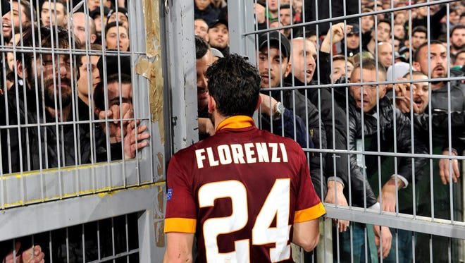 AS Roma's Alessandro Florenzi speaks with his supporters at the end of UEFA Europa League round of 16 second leg at the Olimpico stadium.