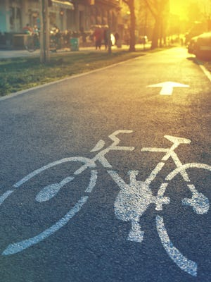Wisconsin Gov. Scott Walker has proposed repeal of state requirements that new road projects be built with bicyclist and pedestrian needs included.