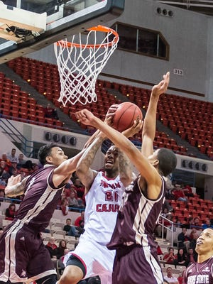 UL's Shawn Long (21) gets fouled while going to the basket in Thursday night's win over Texas State. Thursday Jan. 28, 2016.