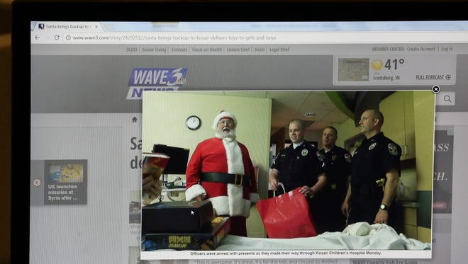 """Former LMPD Officer Kenneth Betts (holding red bag) visits a children's hospital in a WAVE 3 story December 2013 amid an investigation of him having """"improper contact"""" with a teenage girl. April 7, 2017"""