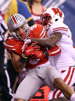 Wide receiver Devin Smith (9) scores Ohio State's first TD Saturday during the Big Ten Championship.