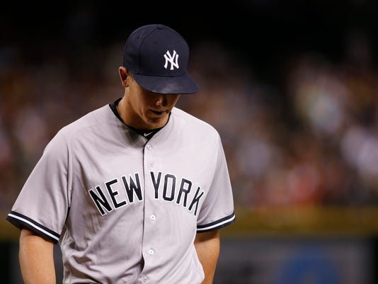 New York Yankees pitcher Chad Green walks back to the dugout after being pulled during the fifth inning of a baseball game against the Arizona Diamondbacks Monday, May 16, 2016, in Phoenix. (AP Photo/Ross D. Franklin)