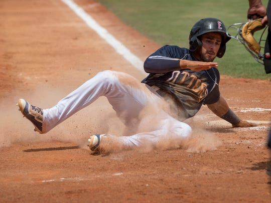 Evansville's Chris Riopedre scores what would be the winning run after tagging up at third base on teammate John Schultz' pinch-hit sacrifice fly against the Gateway Grizzlies at Bosse Field Wednesday afternoon. The Otters beat the Grizzlies 1-0.