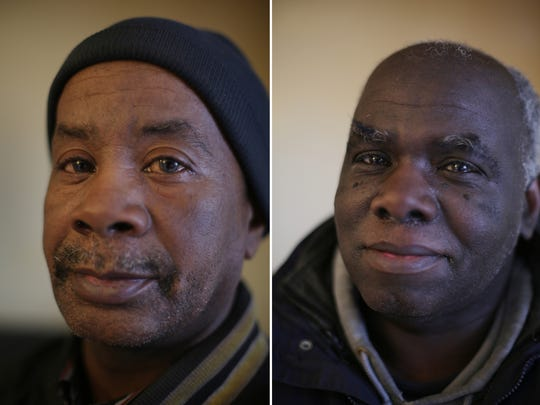 James Thompson, 57, (right) and Jimmie Thompson, 58, brothers from Flint, walk 2 miles to pick up water in Flint on Friday, Jan. 22, 2016.