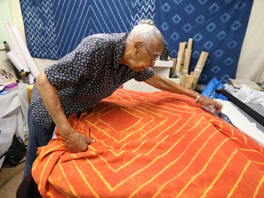 Elmer Lucille Allen with a piece of textile art created using the Shibori method of dying fabric.  Allen was recently awarded the Kentucky Museum of Art and Craft's first Art and Advocacy Award.   October 8, 2015