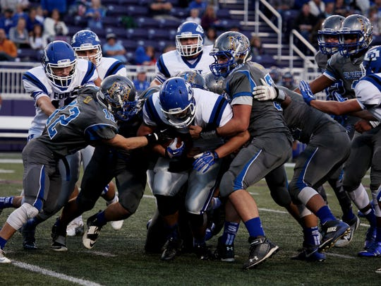 Spotswood High School defenders tackle Fort Defiance's Austin Fitzwater on Saturday, Oct. 15, 2016 at James Madison University's Bridgeforth Stadium in Harrisonburg, VA during the final game of the inaugural Shenandoah Valley High School Football Classic.