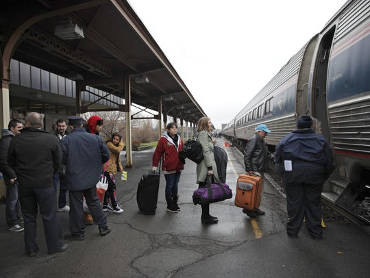 Passengers boarding the eastbound Lake Shore Limited