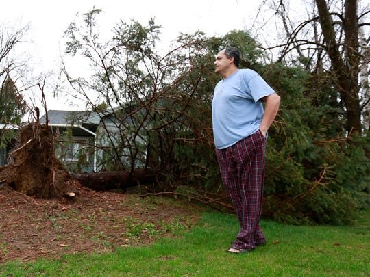 Todd Steinfest woke up to see his favorite tree down by the storm Monday morning at his house in Wausau.