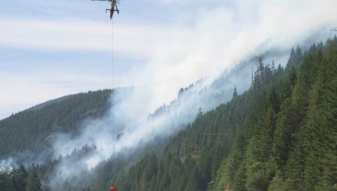 The Oregon Department of Forestry reported there is an approximately 30-acre wildfire burning along Highway 22 near Big Cliff Dam and Detroit Lake Dam on Saturday, July 4.