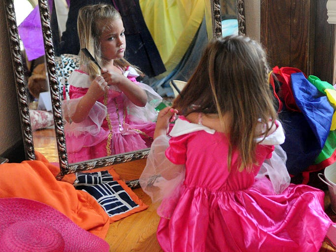 Elizabeth Shemper, 4, looks in the mirror while combing her hair Tuesday before the Happy Hatter's Artie Club Tea Party at the Hattiesburg Cultural Center.