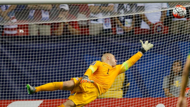 The ball gets past United States goalkeeper Brad Guzan for a Jamaica goal during the first half of a CONCACAF Gold Cup soccer semifinal. Wednesday, July 22, 2015, in Atlanta.