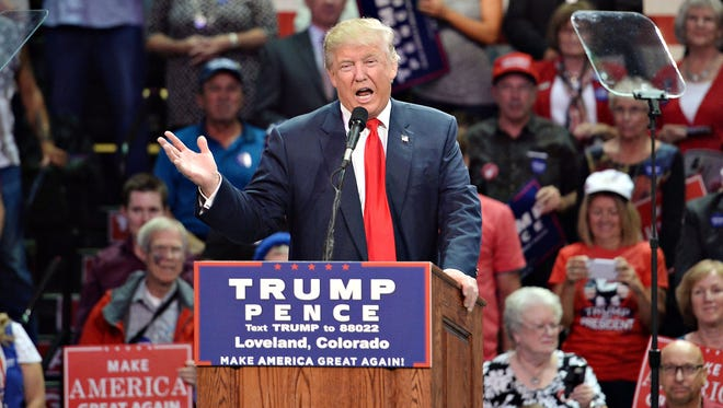 Donald Trump speaks at a rally at the Budweiser Event Center in Loveland on October 3, 2016. Trump is under pressure from fellow Republicans to quit his campaign following the release of vulgar comments he made about women.