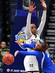 Kentucky Wildcats guard Makenzie Cann (22) looks to pass the ball defended by Mississippi State Lady Bulldogs center Zion Campbell (25) during the first half of the SEC Conference Tournament at Bridgestone Arena. Mandatory Credit: Christopher Hanewinckel-USA TODAY Sports