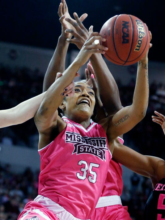 Mississippi State guard Victoria Vivians (35) attempts a layup through the defense of Texas A&M players in the first half of an NCAA college basketball game in Starkville, Miss., Sunday Feb. 18, 2018. (AP Photo/Rogelio V. Solis)