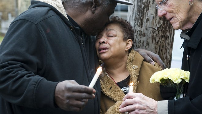 Neighborhood residents participate in a peace walk in December 2012 for Camden murder victim Georgianna Jedrzejewski, as mourner Luz Padilla of Camden (center) is comforted by Ricky Johnson of Camden. The Camden County Police Department's Cold Case Unit has just announced an arrest in Jedrzejewski's slaying.