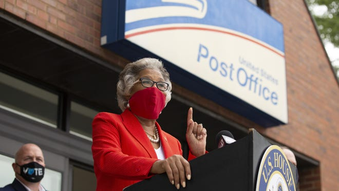 Rep. Joyce Beatty demands the White House stop interfering with the United States Postal Service during a news conference outside the Oakland Park Station of the USPS in Columbus on Tuesday.
