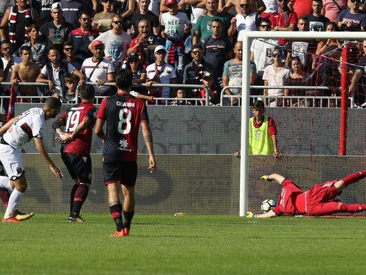 Genoa's Adel Taarabt, left, scores during the Serie A soccer match between Cagliari and Genoa, in Cagliari, Italy, Sunday, Oct. 15, 2017. (Fabio Murru/ANSA via AP)