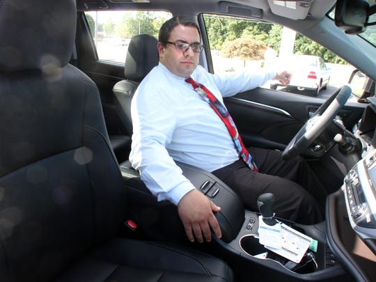 Galaxy Toyota sales associate Adam T. Iorlano shows