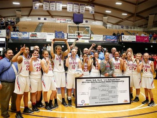 Evina Westbrook (No. 22, front left) and Katie McWilliams (holding trophy) were teammates on South Salem's Class 6A state championship team in 2015.