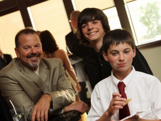 John Hendry, with sons Alex and Max, 2011