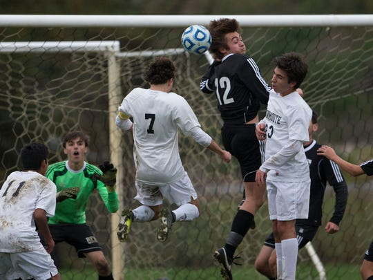 Monmouth Regional's Ted Fisher heads the ball towards goal but misses wide during first half action. Monmouth Regional Boys Soccer vs Rumson-Fair Haven in State Sectional Semifinal Soccer in Tinton Fall, NJ on November 7, 2017
