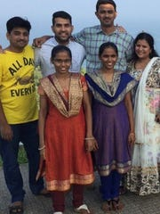 Family members traveling in Visakhapatnam, India, in 2015. Sai Kota of Edison is in the center of the back row, to the left of his cousin Srinivas Kuchibhotla. With them in the back row is Kuchibhotla's  cousin Nani. In the front are, from left, his sisters, Laxmi and Rama, and his wife, Sunayana Dumala.