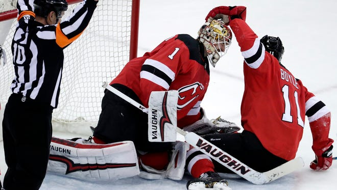 New Jersey Devils goaltender Keith Kinkaid (1) and center Brian Boyle (11) celebrate after defeating the Tampa Bay Lightning in an NHL hockey game, Saturday, March 24, 2018, in Newark, N.J.