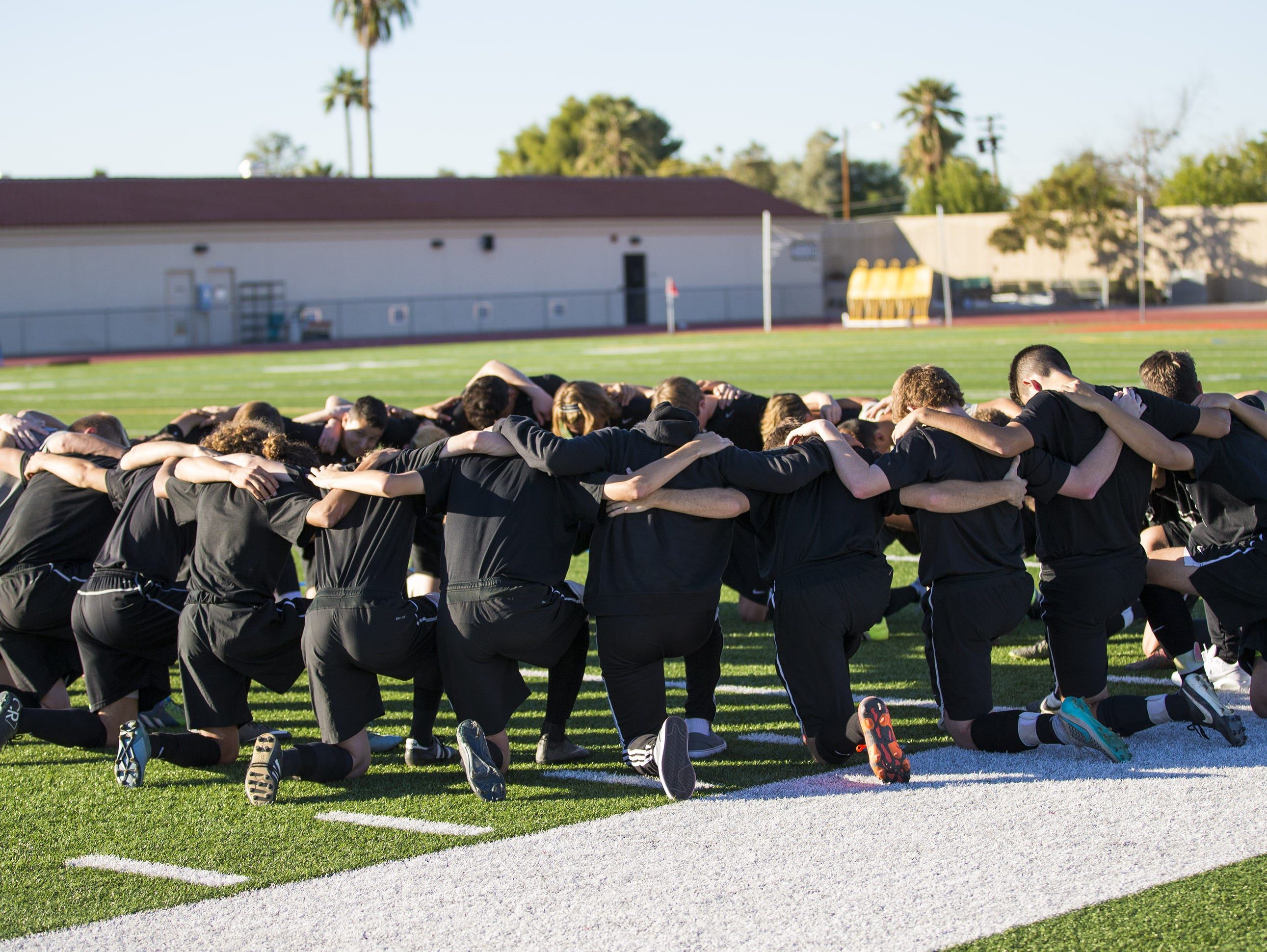 Hamilton High players huddle before playing a friendly against Brophy in Phoenix November 23, 2015.