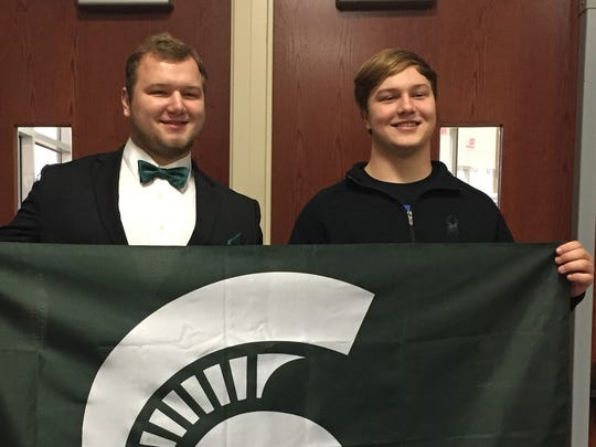 Jacub Panasiuk, right, is a three-star defensive end
