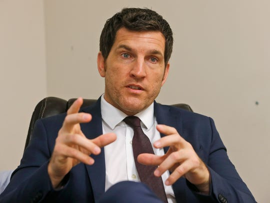 Virginia's 2nd District Congressman Scott Taylor speaks during an interview in his campaign office in Virginia Beach, Va.