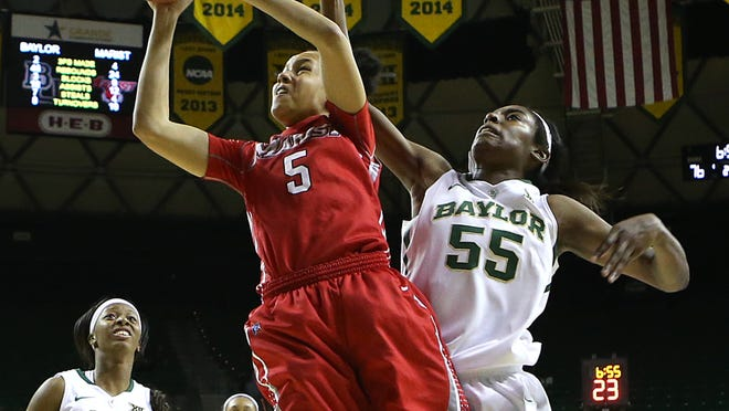 Marist College's Sydney Coffey is fouled as she shoots in front of Baylor Khadijiah Cave on Nov. 30, 2014 in Waco, Texas.