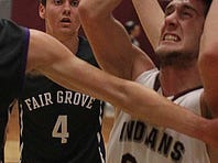 Strafford's Tyler Winburn slips past Zane McCurry of Fair Grove during Monday's Class 3 District 11 title game.