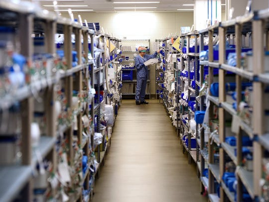 Rows and rows of sterilized instruments are prepared for use in surgeries Dec. 11, 2015 at St. Cloud Hospital.