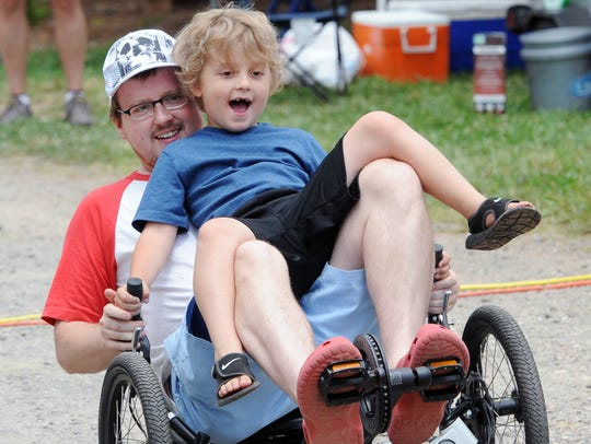 Chad Pry and his son Eliot, of Asheville, enjoy a spin
