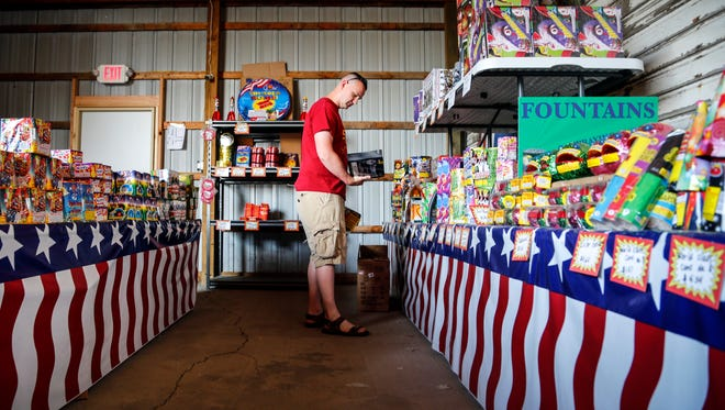 Brant Archer of shops for fireworks at Shooters Fireworks in Grimes Tuesday, June 13, 2017.