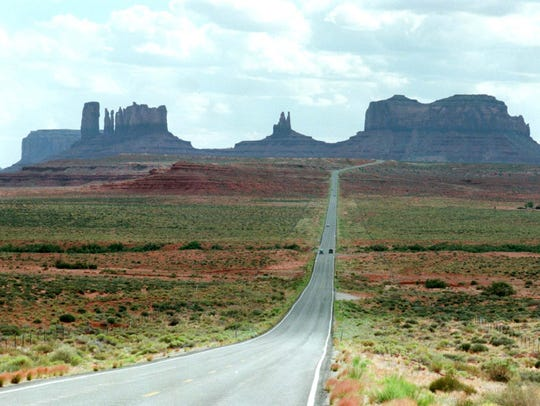Highway 163 snakes through Monument Valley on the Navajo