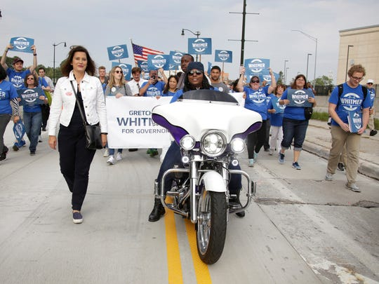 Gubernatorial candidate and former minority leader of the Michigan Senate Gretchen Whitmer marches with supporters as she participates in the Labor Day Parade in Detroit Monday Sep. 4, 2017.
