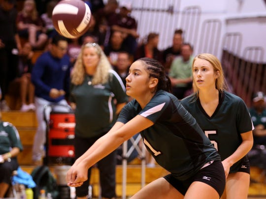 Taft Greyhound Anisa Martinez (left) returns the ball in game two of the regional quarterfinals against the London Pirates at Calallen High School on Monday, November 6, 2017. London won the match in three sets.