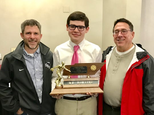St. Benedict junior bowler Nick Agnew (center) is congratulated for receiving the Tennessee State Secondary Athletic Association (TSSAA) Boys Bowler of the Year Award from Head Coach Eric Wells (left) and Assistant Coach Johnny Cordera.