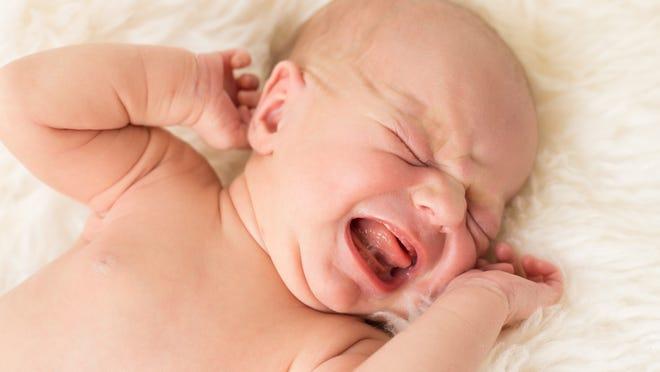A newborn baby crying