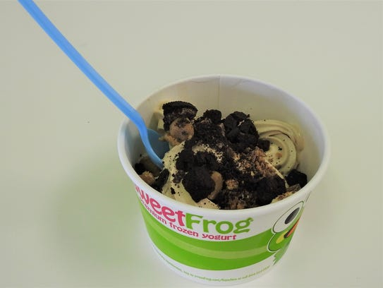 A variety of frozen yogurt and toppings are available