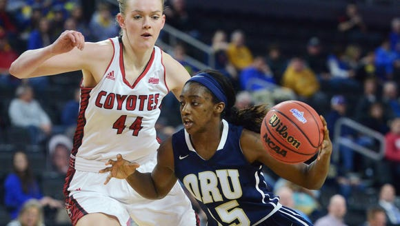 Oral Roberts' Faith Ihim (15) drives past USD's Abigail