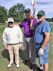 Bob Robinson, center, with Holly Hanes and Dick Pillsbury.