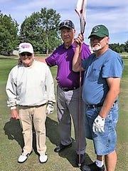 Bob Robinson, center, with Holly Hanes and Dick Pillsbury.