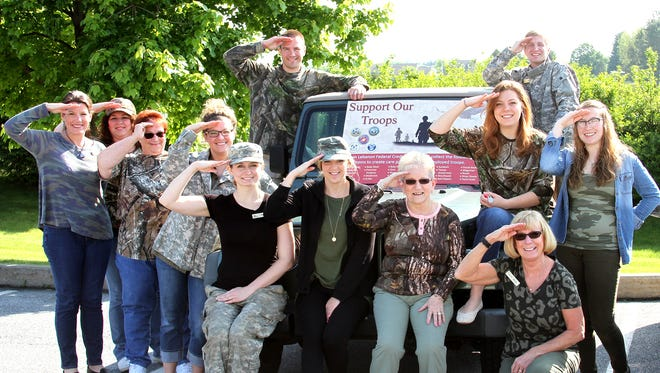 During May, the Lebanon Federal Credit Union collects supplies at each office for U.S. troops. Employees and members collected over 140 pounds of supplies, including shampoo, conditioner, hand and body lotion, body wash, feminine produts, deodorant, gum, shaving cream, toothpaste, tooth brushes, foot powders, razors, Chapstick, mouthwash, sun block, tissues, nail clippers, magazines, books and hard candy. This is the fifth year in a row that LFCU collected items for the troops. Pictured are, from left, Tina Gerhart, Valisha Kimm, Karen Stine, Sarah Monk, Tiffany Kolar, Alaina Smith, Sue Getz, Nancy Lynn-Houser, Chris Pastal, Jo Jo Strickler, Brittany Fees, Jolene Schott. The credit union has offices at 300 Schneider Drive, Lebanon; 301 E. Evergreen Road, South Lebanon Township; and 653 E. Lincoln Ave., Myerstown.