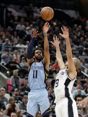 Memphis Grizzlies guard Mike Conley (11) shoots over San Antonio Spurs guard Tony Parker (9) during the first half in Game 2 on Monday, April 17, 2017, in San Antonio.