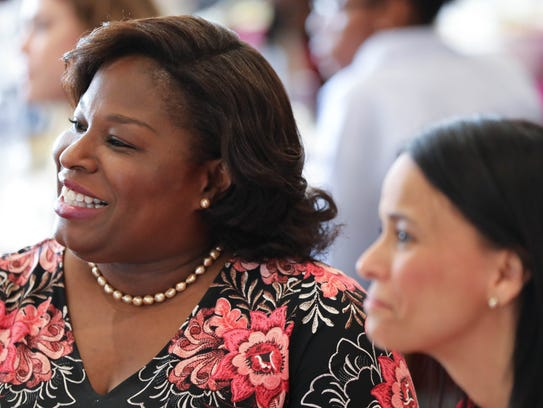 Paula Deboles Johnson, left, seated with Marcia Warfel, listening to the 10th Annual Women's History Month Luncheon presentation in March.